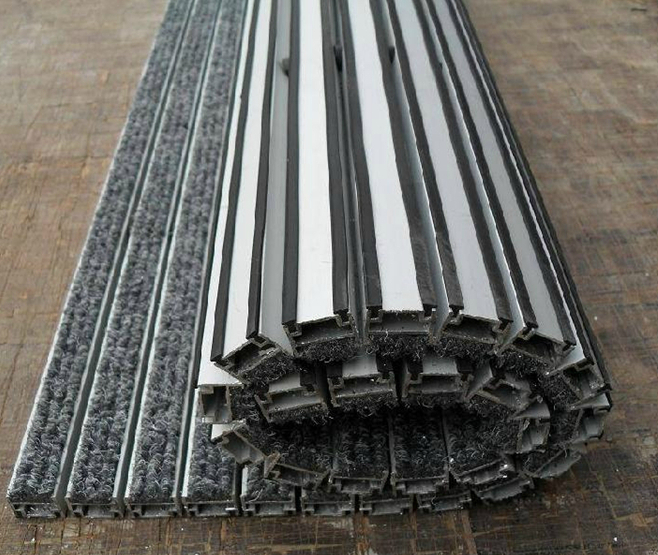 аллюминиевая грязезащитная решетка